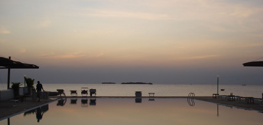 Mtoni Marine Lodge pool at sunset <span class='overlay-readmore'>Read more</span>